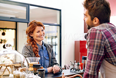 Buy stock photo Shot of a young woman ordering coffee in a cafe
