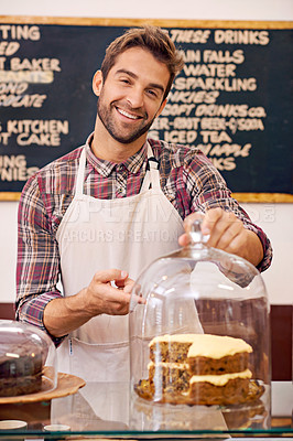 Buy stock photo Shot of a barista pointing to cake