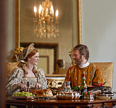 Buy stock photo A regal king and queen enjoying a meal together
