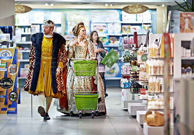 Buy stock photo A king and queen browsing in a supermarket