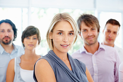 Buy stock photo Beautiful young business woman with her team in background