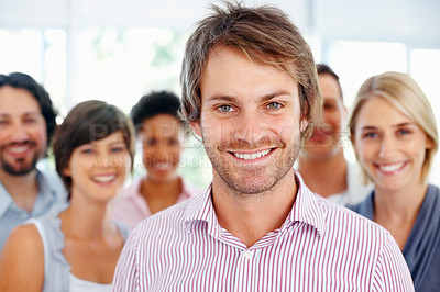 Buy stock photo Closeup of smart business man with friendly colleagues in background