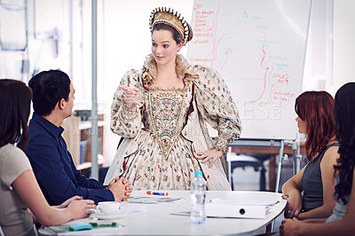 Buy stock photo A queen giving a presentation to her staff