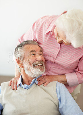 Buy stock photo Shot of a wife lovingly massaging her senior husband's shoulders