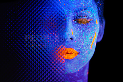 Buy stock photo Shot of a young  woman posing with neon paint on her face