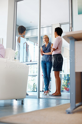 Buy stock photo Low angle view of three businesswomen having a friendly discussion
