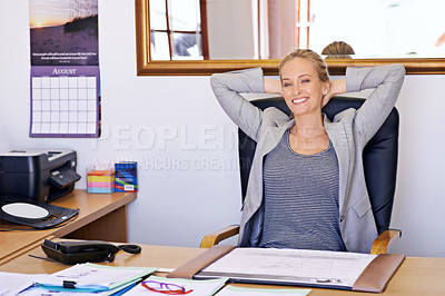 Buy stock photo Shot of an attractive young woman sitting at her desk in an office