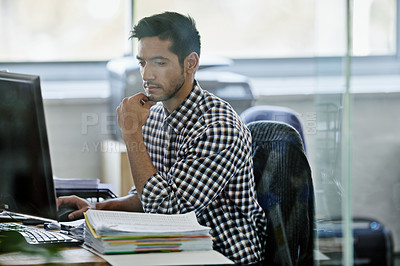 Buy stock photo Cropped shot of a handsome young designer working on a pc