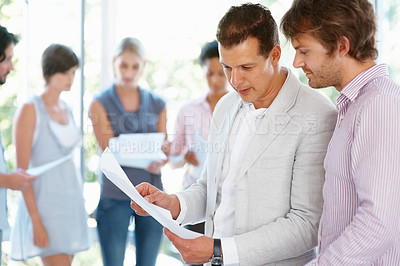 Buy stock photo Business man looking at the document with his leader