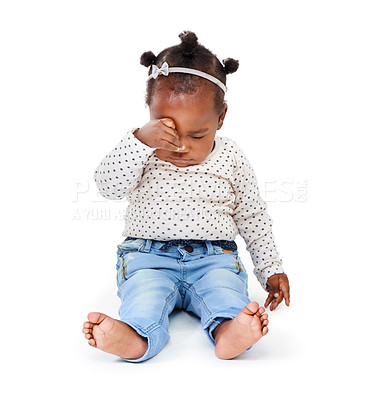 Buy stock photo Studio shot of an adorable baby girl looking tired isolated on white