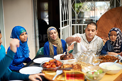Buy stock photo Shot of a muslim family eating together
