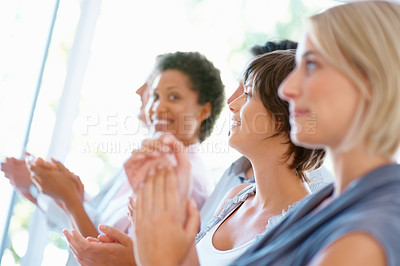 Buy stock photo Successful business people standing in row and clapping
