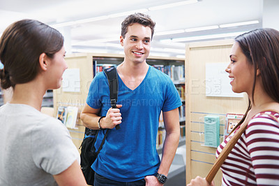 Buy stock photo Shot of a group of students discussing their plans for the next assignment