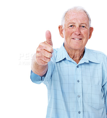 Buy stock photo Studio portrait of an elderly man giving the thumbs up to the camera isolated on white