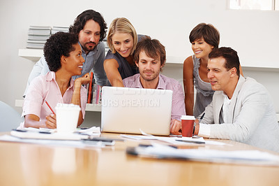 Buy stock photo Young female executive showing something to the team in laptop