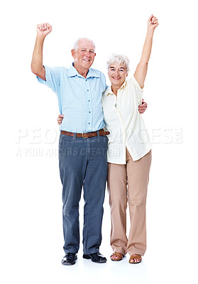 Buy stock photo Full length studio portrait of an elderly couple with their arms raised in celebration isolated on white