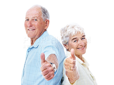 Buy stock photo Studio portrait of an elderly couple standing back to back and giving the thumbs up isolated on white