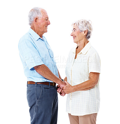 Buy stock photo Studio shot of an affectionate elderly couple holding hands isolated on white