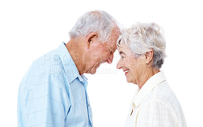 Buy stock photo Studio shot of a smiling elderly couple standing with their heads together isolated on white