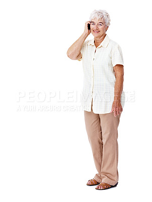 Buy stock photo Full length studio shot of a smiling elderly woman talking on a cellphone isolated on white
