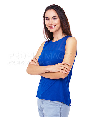 Buy stock photo Portrait of an attractive young woman standing with her arms folded against a white background