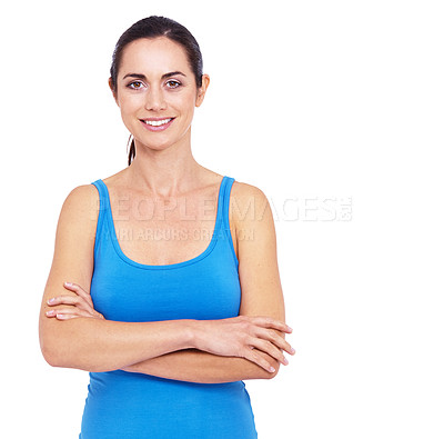 Buy stock photo Cropped shot of a sporty young woman standing with her arms folded against a white background