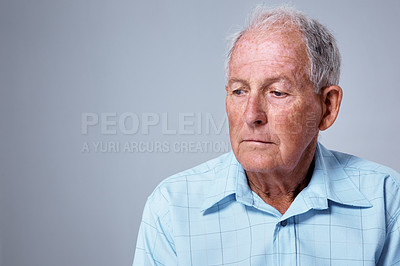 Buy stock photo Studio shot of an elderly man against a gray background