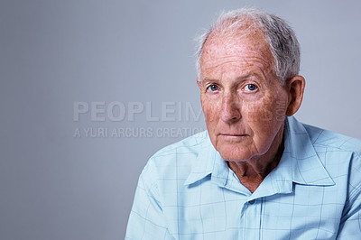 Buy stock photo Studio portrait of an elderly man against a gray background