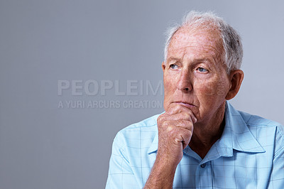 Buy stock photo Studio shot of a depressed elderly man against a gray background