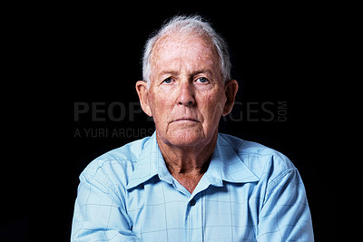 Buy stock photo Head and shoulders studio portrait of an elderly man isolated on black