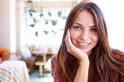Buy stock photo Portrait of a beautiful woman sitting at a coffee shop with copyspace