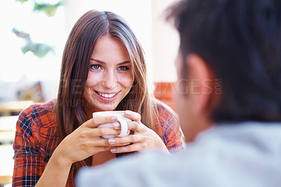 Buy stock photo Shot of a smiling woman on a date holding a cup of coffee