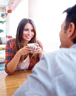 Buy stock photo Shot of a smiling woman on a date holding a cup of coffee with copyspace
