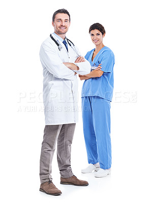Buy stock photo Portrait of a doctor and nurse with their arms crossed smiling at the camera against a white background