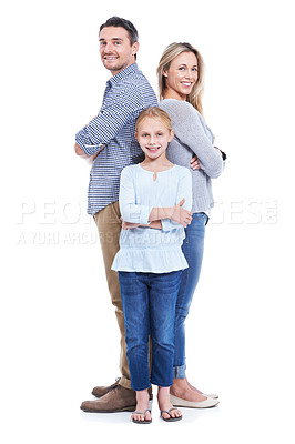 Buy stock photo Studio shot of a happy family consisting of a mother, daughter and father standing back to back with their arms folded