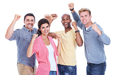 Buy stock photo Four coworkers cheering and raising their fists in victory while isolated on white