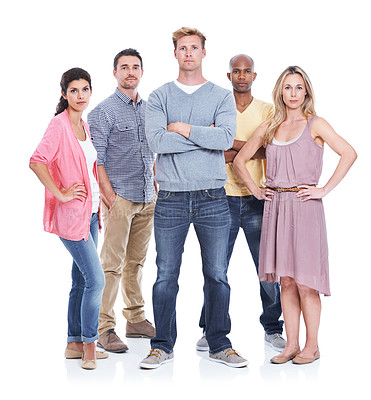 Buy stock photo A group of serious coworkers standing together while isolated on white