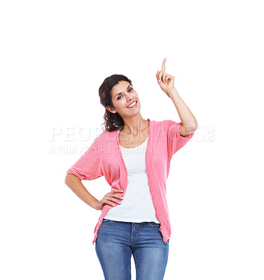 Buy stock photo An attractive brunette pointing away while isolated on white with a smile