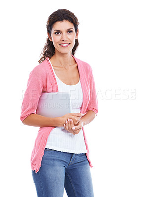Buy stock photo An attractive brunette smiling while holding her digital tablet and isolated on white