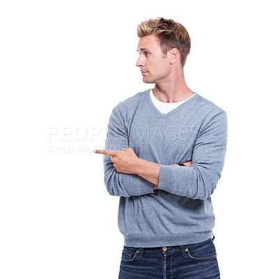 Buy stock photo Cropped shot of a handsome man pointing away while isolated on white