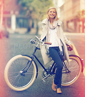 Buy stock photo Full length portrait of an attractive young woman leaning against her bicycle in the city