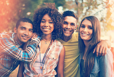 Buy stock photo Portrait of a group of young friends hanging out together outside