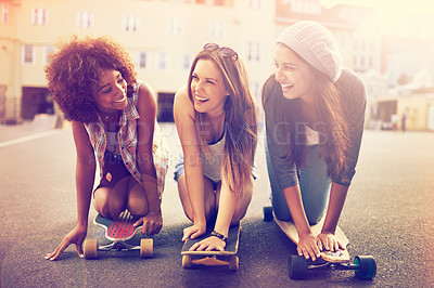 Buy stock photo Shot of a group of young women skateboarding together