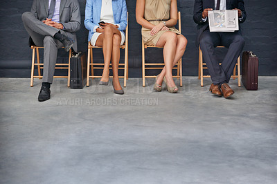 Buy stock photo Shot of a group of unrecognizable businesspeople sitting in a row