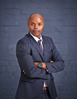 Buy stock photo Portrait of a successful young businessman standing with his arms folded