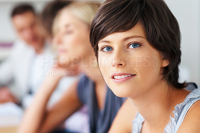 Buy stock photo Closeup of pretty young woman with staff in background