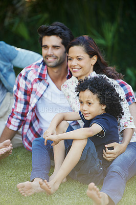 Buy stock photo Shot of a young family enjoying some time outdoors