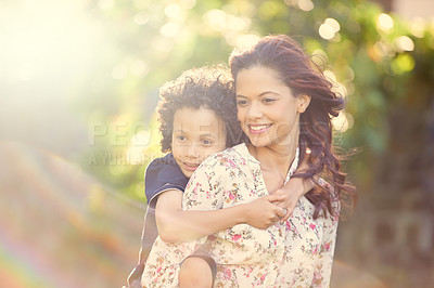 Buy stock photo Shot of a mother giving her son a piggyback ride