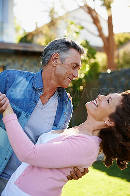 Buy stock photo A loving mature couple spending time outdoors together