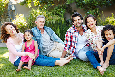 Buy stock photo Three generations of a happy family spending time together in the park